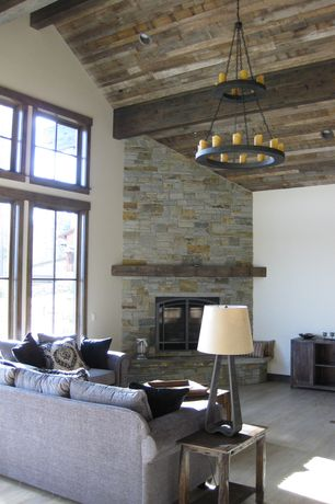 Rustic Living Room with Chandelier, Old Iron Two-Tier Candle Chandelier, Coleman Furniture Weatherford Chair Side Table