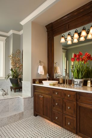 Traditional Master Bathroom with Complex marble counters, Double sink, Flush, drop in bathtub, Wall Tiles, Standard height