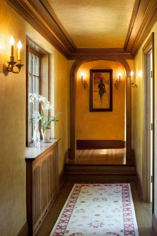 Craftsman Hallway with Casement, Crown molding, Built-in bookshelf, Hardwood floors, Standard height, Wall sconce