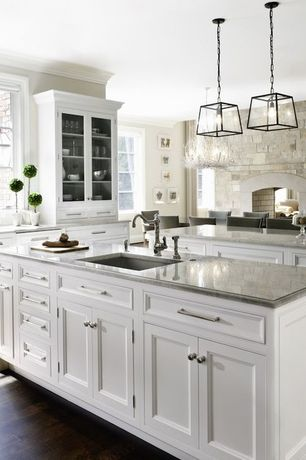 Traditional Kitchen with Kitchen island, Glass panel, MS International Bianco Catalina Granite Countertop, Pendant light