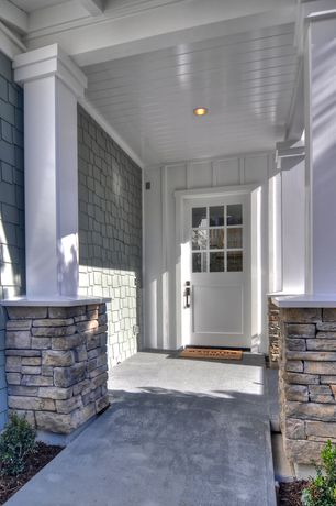 Cottage Front Door with Pillars, Painted wood panel ceiling, Cement walk, Stone surrounding, Glass panel door, Wood shingle