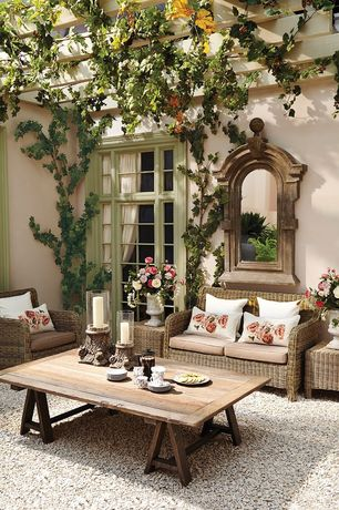 Cottage Patio with Restoration hardware benson coffee table, Outdoor seating, Casement, Trellis, exterior tile floors, Gravel