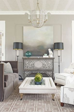 Traditional Living Room with Restoration Hardware Tufted Coffee Ottoman, Chandelier, Crown molding, Carpet