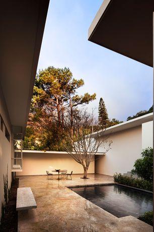 Modern Patio with exterior stone floors, Pond, Bay window, Pathway