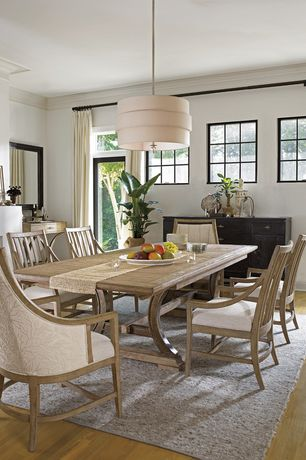 Contemporary Dining Room with West elm- metallic pinstripe wool dhurrie rug, Cement fireplace, Paint 1, Fireplace