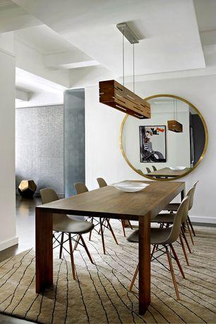 Modern Dining Room with Pendant light, Concrete floors