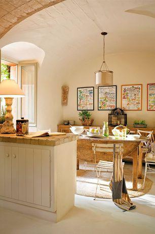 Rustic Dining Room with Standard height, Robert abbey saturina bronze pendant chandelier, Casement, Pendant light, Paint