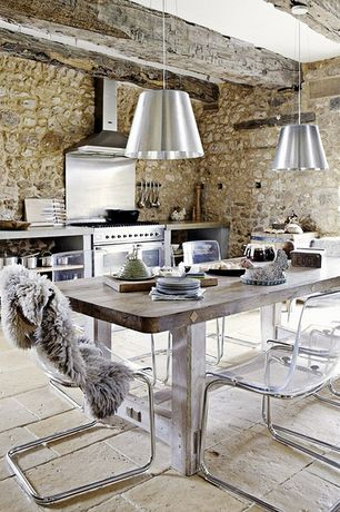 Rustic Kitchen with limestone tile floors, Soapstone counters, Pendant light, One-wall, Breakfast nook, Wood counters