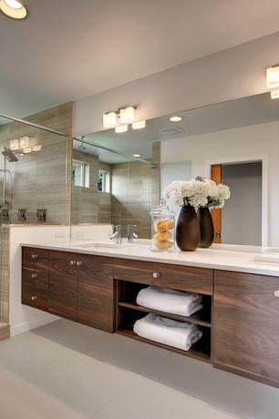 Modern Master Bathroom with Flush, can lights, European Cabinets, Double sink, flat door, Undermount sink, Corian counters