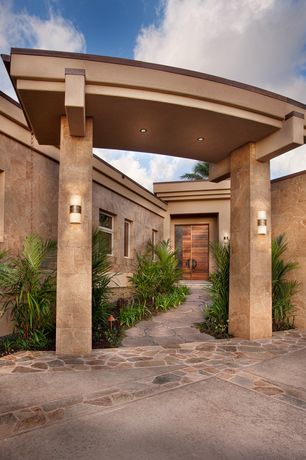 Tropical Front of Home with Partial stone exterior, Residence at moani'ala hawaii loa ridge oahu, exterior stone floors