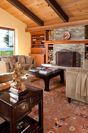 Craftsman Living Room with Carpet, stone fireplace, picture window, Standard height, Exposed beam, Built-in bookshelf, Paint