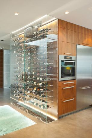 Contemporary Wine Cellar with Stainless Steel, Built-in bookshelf, Concrete floors, Standard height, can lights