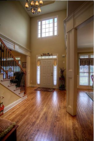 Traditional Entryway with Chandelier, Transom window, High ceiling, six panel door, picture window, Hardwood floors