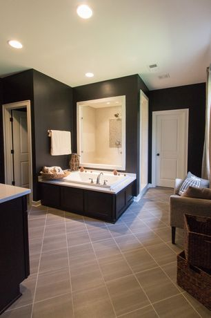 "Contemporary Master Bathroom with 12"" x 24"" sandstone tile, frameless showerdoor, Travertine counters, Flat panel cabinets"
