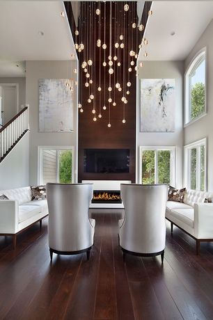 Contemporary Living Room with Bocci rectangle pendant chandelier, Pendant light, Hardwood floors, Arched window