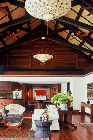 Tropical Great Room with Crown molding, Cathedral ceiling, Chandelier, Exposed beam, Hardwood floors, Pendant light