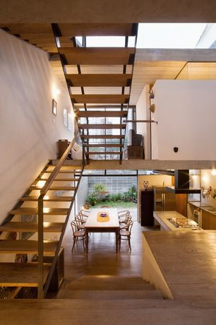 Contemporary Staircase with Wall sconce, Hardwood floors, curved staircase, picture window, High ceiling