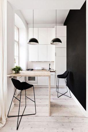 Modern Dining Room with Pendant light, Hardwood floors, Built-in bookshelf