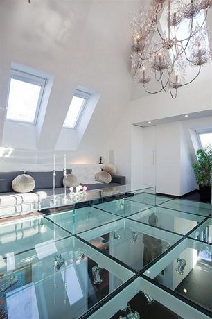 Contemporary Living Room with Glass floor, Sectional sofa, Skylight, Chandelier, High ceiling, can lights