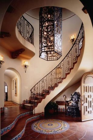 Mediterranean room with Wall sconce, specialty door, Pendant light, Wrought iron railing, Arched doorway, Paint 1