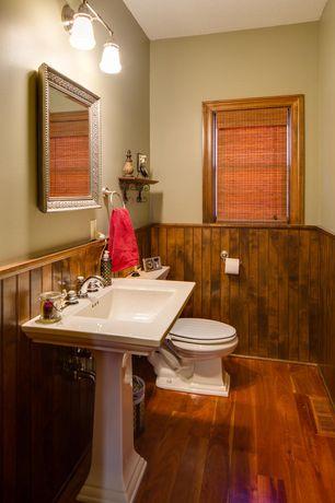 Country Powder Room with Designview natural bamboo sedona roman shade, Pedestal sink, Hardwood floors, Wainscotting