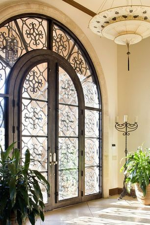 Front Door with Transom window, exterior stone floors, French doors