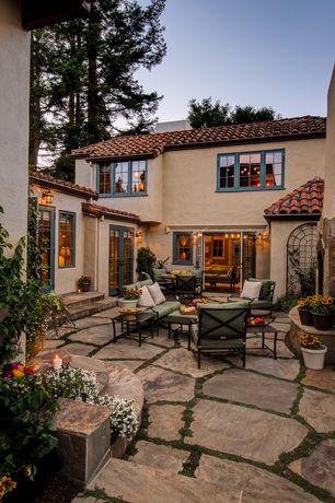Mediterranean Patio with Outdoor furniture, Casement, French doors, Flagstone patio, exterior stone floors