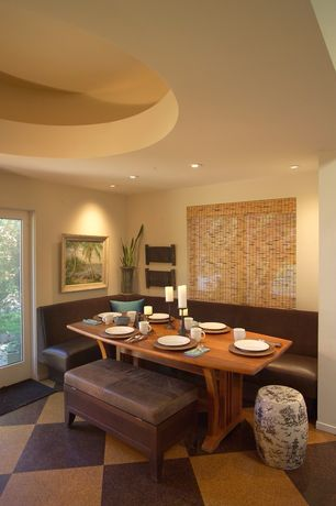 Eclectic Dining Room with French doors, High ceiling, can lights, Built-in bookshelf, Concrete floors