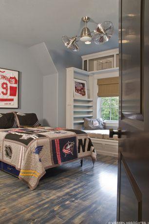 Traditional Kids Bedroom with flush light, Standard height, Built-in bookshelf, Hardwood floors, no bedroom feature, Casement