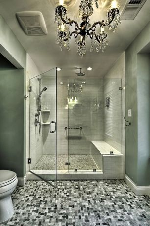 Contemporary Master Bathroom with Chandelier, frameless showerdoor, can lights, Shower, three quarter bath, Shower bench