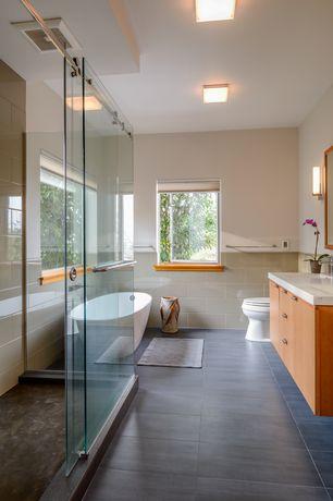 Contemporary Master Bathroom with Waterworks optix glacier bay field tile 12 x 24, Freestanding, European Cabinets, Flush
