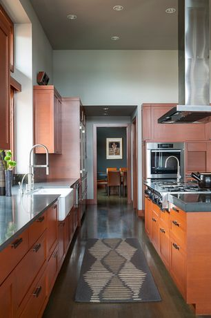 Contemporary Kitchen with Complex Granite, Flat panel cabinets, Kitchen island, Farmhouse sink, High ceiling, Inset cabinets