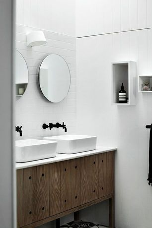 Contemporary Master Bathroom with European Cabinets, Wall sconce, Master bathroom, Simple marble counters, Vessel sink, Flush