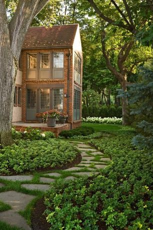 Traditional Landscape/Yard with exterior stone floors, Fence, specialty window, Pathway