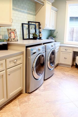 Traditional Laundry Room with laundry sink, Casement, drop-in sink, stone tile floors, Hanging Bar, sandstone tile floors