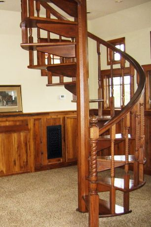 Country Staircase with Wood paneling, Spiral staircase, Wainscotting, Carpet