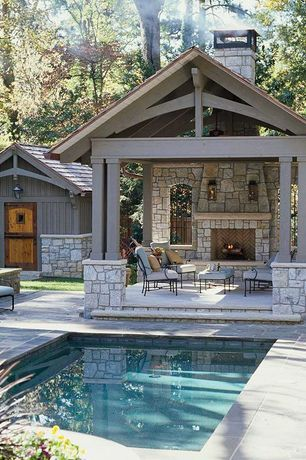 Traditional Porch with Barn door, Reflection pool, Fence, Stacked stone fireplace, exterior stone floors, Paint, Gazebo