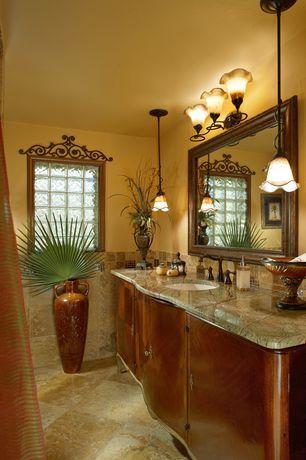 Craftsman Full Bathroom with Stone Tile, European Cabinets, Undermount sink, Casement, limestone tile floors, Pendant light