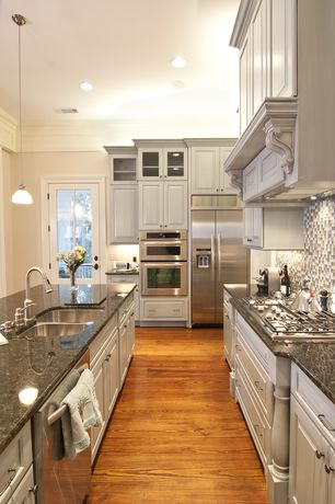 Traditional Kitchen with Undermount sink, L-shaped, Flush, Ceramic Tile, Raised panel, Glass panel, Kitchen island