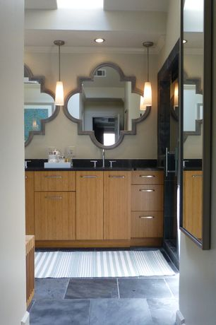 Contemporary Master Bathroom with Standard height, Skylight, can lights, Pendant light, Flush, Undermount sink, Crown molding