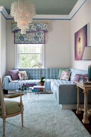 Traditional Living Room with Area rug, Bubble blown glass chandelier, Tufted sectional, Standard height, Hardwood floors