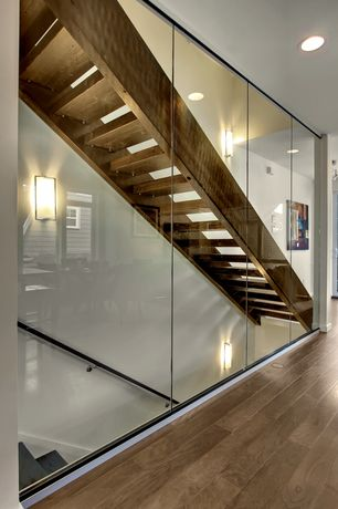 Staircase with Wall sconce, High ceiling, Hardwood floors