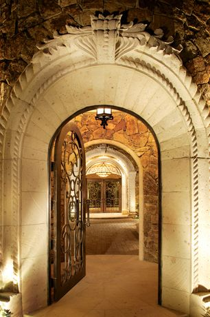 Traditional Front Door with Arched doorway, French doors, exterior stone floors, Arched door