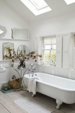 Traditional Full Bathroom with Full Bath, Casement, Hardwood floors, Bathtub, Standard height, Skylight, Wainscotting