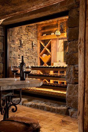 Rustic Wine Cellar with Built-in bookshelf, sandstone floors