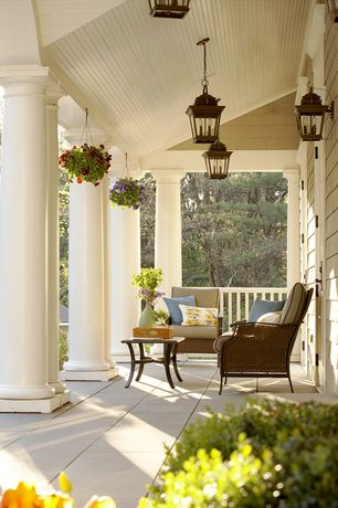 Traditional Porch with Weather-resistant stone flooring, Doric columns, Wrap around porch, Outdoor seating, Exterior paint