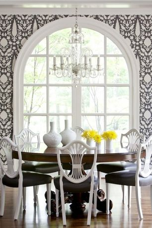 Contemporary Dining Room with interior wallpaper, Pedestal dining table, Arched window, Chandelier, Crown molding