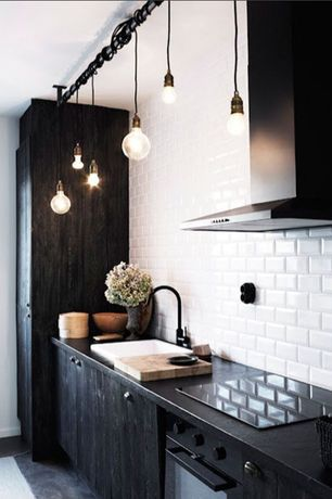 Contemporary Kitchen with Paint 2, Slate counters, full backsplash, Weathered black stained cabinets, slate floors, Wall Hood