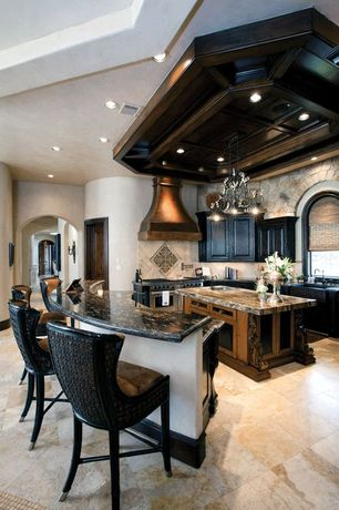 Mediterranean Kitchen with Undermount sink, High ceiling, Chandelier, Raised panel, Stone Tile, Arched window, Farmhouse sink