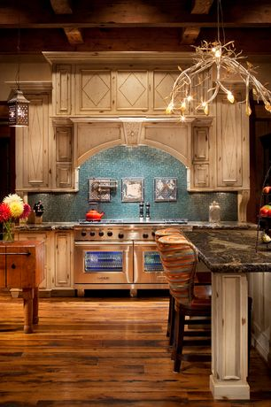 Eclectic Kitchen with Breakfast bar, Murray feiss - moroccan bronze kandira pendant, Complex granite counters, Chandelier